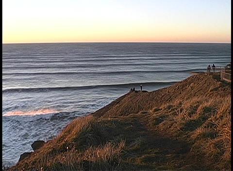 People enjoy a walk along a coastal mountain pathway Stock Video Footage