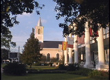 A bird flies over the steeple of a church in St. Martinsville, Louisiana Footage