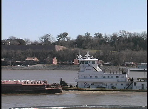 Boats and barges pass slowly by Harpers Ferry, West Virginia Stock Video Footage