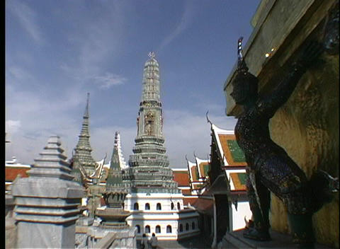 Stone pagodas decorate the rooftops of the buildings of Bangkok, Thailand Footage