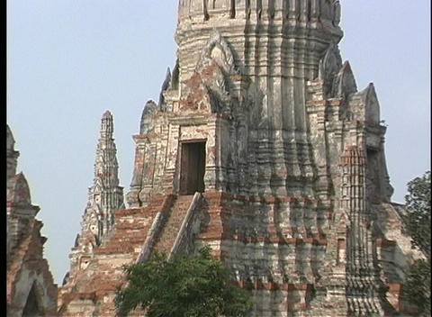 A lush courtyard surrounds the ancient stone temples of... Stock Video Footage
