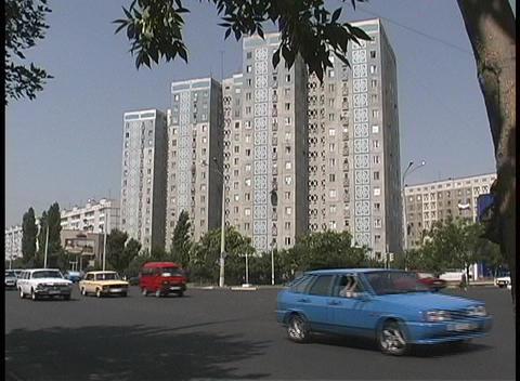 Traffic travels along a busy street in Tashkent, Uzbekistan Stock Video Footage
