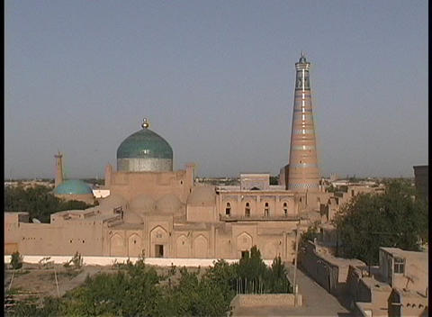The Juma minaret and mosque domes adorn the blue sky Stock Video Footage