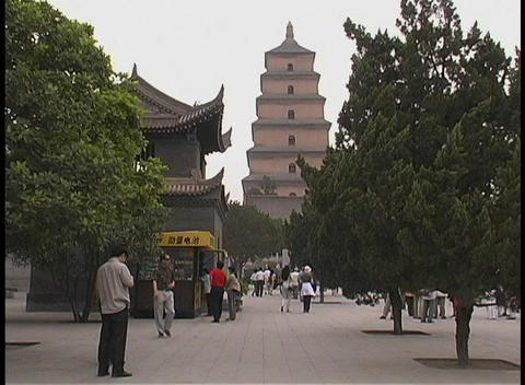 People walk by the Big Goose Pagoda in Xian, China Stock Video Footage