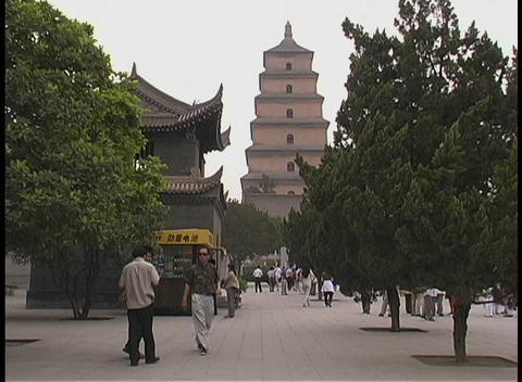 People walk by the Big Goose Pagoda in Xian, China Footage
