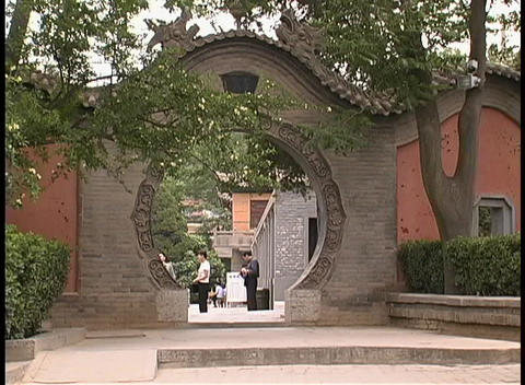 A round gate adorns the entrance to a courtyard in Huaqing, China Footage