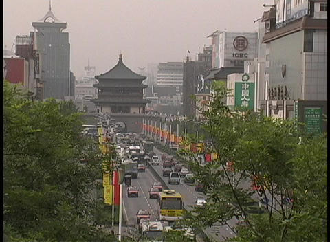 Traffic travels though downtown Xian, China Footage