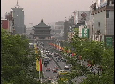 Traffic travels though downtown Xian, China Stock Video Footage
