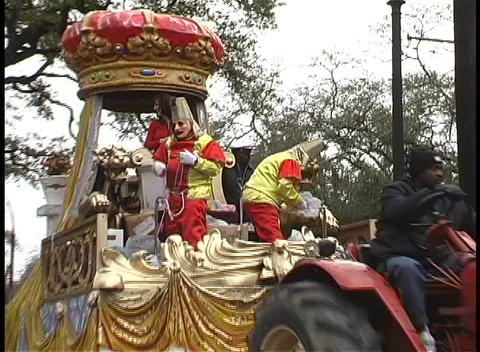 Costumed individuals throw strings of beads from a Mardi... Stock Video Footage