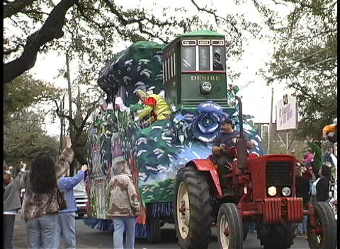 """A Mardi Gras float contains a streetcar called Desire""""... Stock Video Footage"""
