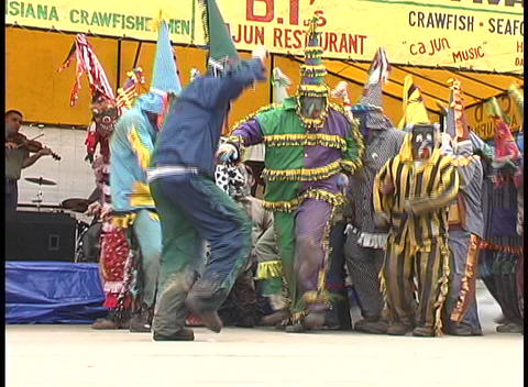 Mardi Gras costumed folks dance outside a tent... Stock Video Footage