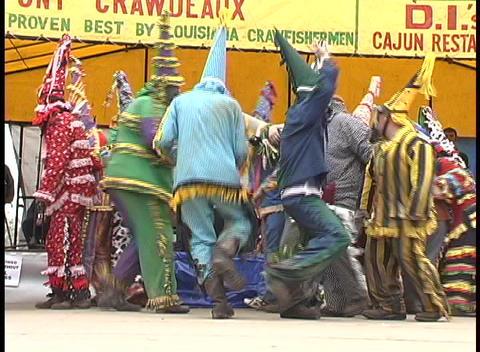 Mardi Gras costumed folks dance outside a tent... Stock Video Footage