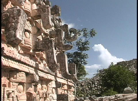 A partial shot of a building shows the carvings done by the ancient Mayans Footage