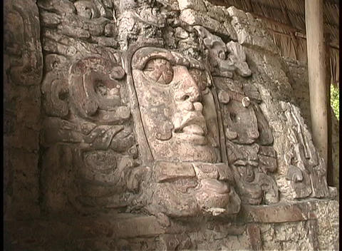 A close-up look at a mask in the Palace of Masks, Kabah, Mexico Footage