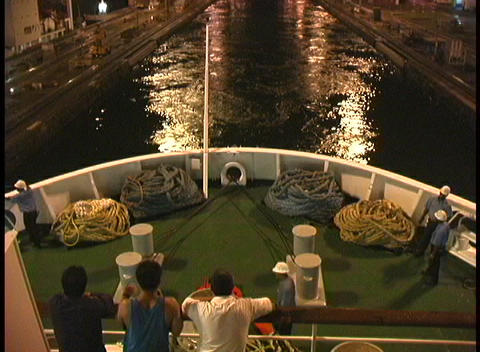 Passengers and crew on a ship watch as it moves through... Stock Video Footage