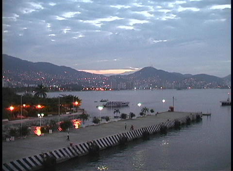 From Acapulco's harbor, city lights are seen scattered... Stock Video Footage