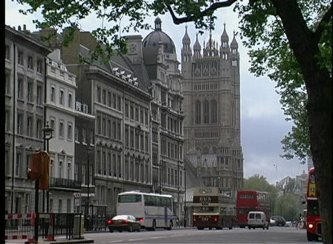 Double decker buses and other automobiles are seen... Stock Video Footage