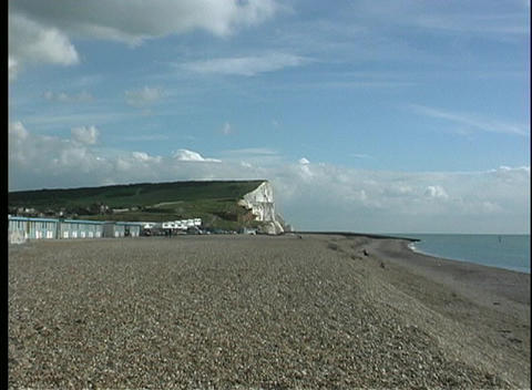 View of a pebbled beach zooms in on the stunning White Cliffs of Dover Footage