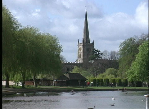 The Holy Trinity Parish Church is seen on the banks of the River Avon, while ducks swim in the gentl Footage