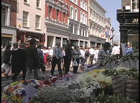 A busy street in Dublin is filled with businessmen and shoppers Footage