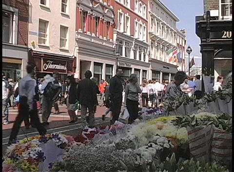 A busy street in Dublin is filled with businessmen and... Stock Video Footage