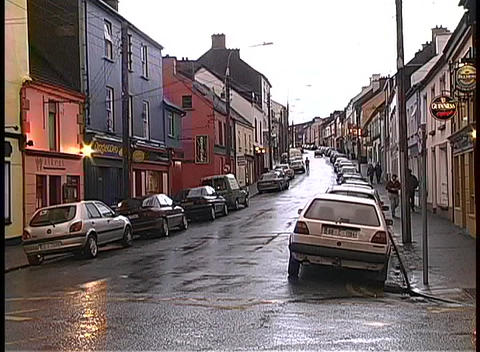 Medium shot of businesses along a rainy street in Dingle,... Stock Video Footage