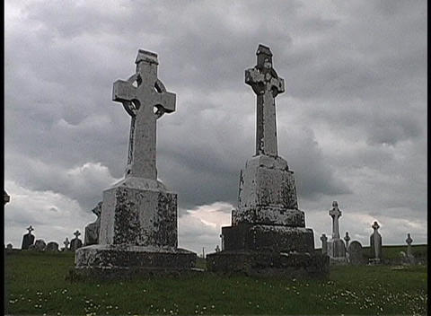 Grave markers adorn the Clonmacnoise cemetery in Ireland Stock Video Footage