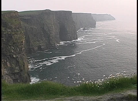 The Cliffs of Moher tower above the ocean in Ireland Stock Video Footage