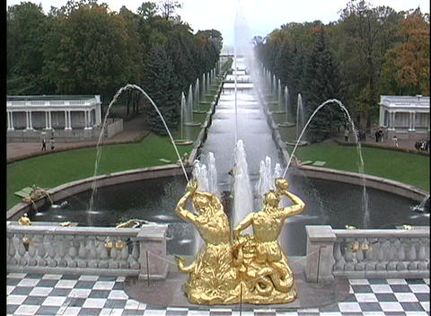 The golden statues of St. Petersburg Petrodvorets spray water into a pond Footage
