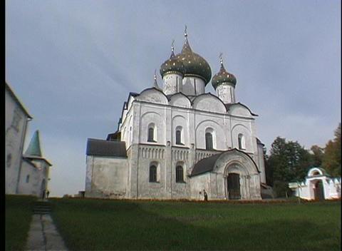 A person walks by Novgorod Christian Russian Orthodox Church Stock Video Footage