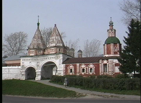 A person walks away from the Suzdal Cathedral in Russia Stock Video Footage