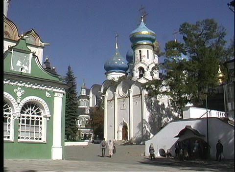A pan shot of people walking toward the Sergiev Posad... Stock Video Footage