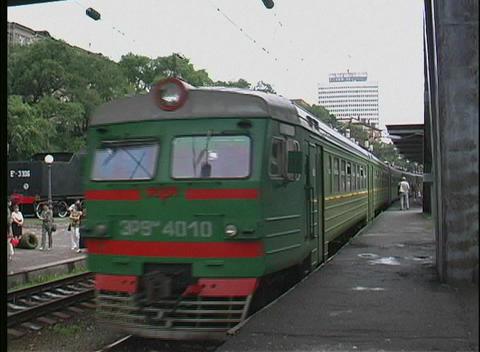 A green trans Siberian railway passenger train pulls into... Stock Video Footage