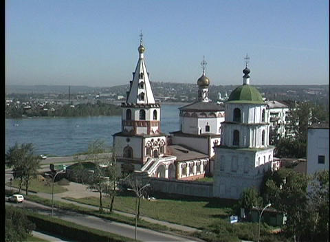 An aerial view of the Irkutsk Church in Russia overlooking a large body of water Footage