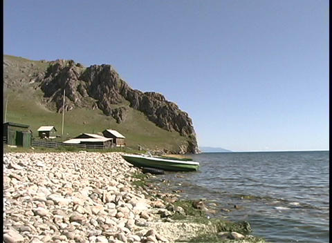 Waves lap along the shoreline of Lake Baikal in Russia Footage