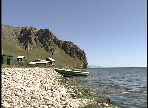 Waves lap along the shoreline of Lake Baikal in Russia Stock Video Footage