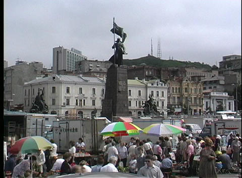 Colorful umbrellas mark the street vendors in Vladivostok... Stock Video Footage