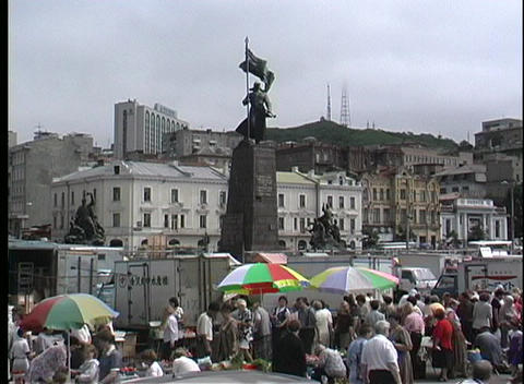 Colorful umbrellas mark the street vendors in Vladivostok Russia Footage