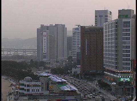 Skyscrapers overlook Haeundae Beach in South Korea Stock Video Footage