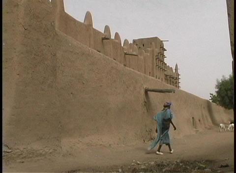 African women in native dress walk along the dusty road... Stock Video Footage
