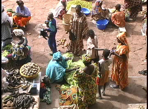 Africans sell produce at an outdoor marketplace Stock Video Footage