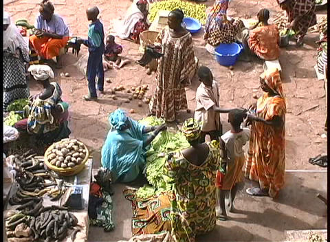 Africans sell produce at an outdoor marketplace Footage