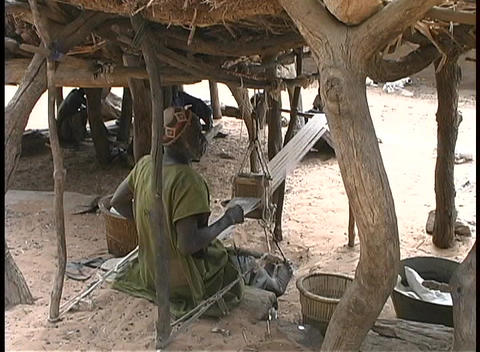 male African weavers work their looms in the shade... Stock Video Footage