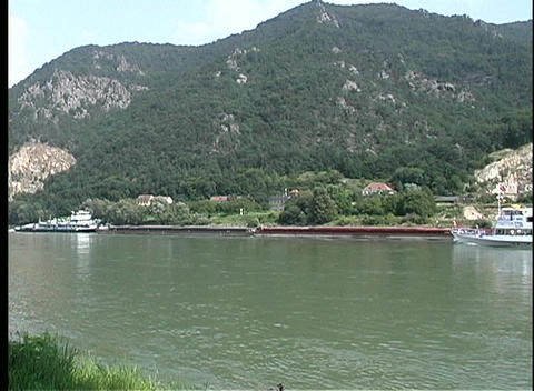 A cruise boat travels along the beautiful Danube River Stock Video Footage