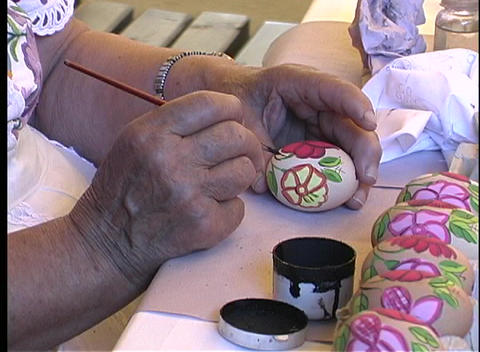 A close-up of a woman's hands painting eggs in Budapest,... Stock Video Footage