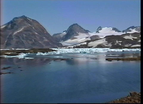 A rugged icy landscape sits at the base of a mountain... Stock Video Footage