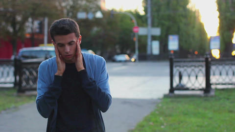 Adult man suffers headache, needs treatment, tablets, pills Footage