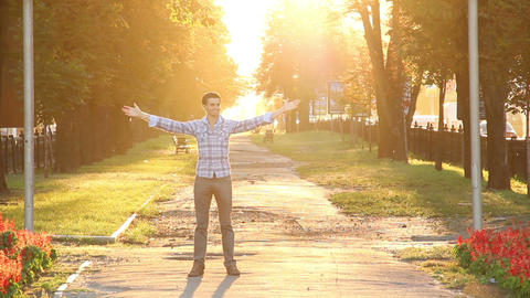 Test passed! Man enjoys himself in sunny park celebrates victory Footage