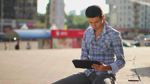 Inspiring information, male browsing tablet pc, getting news Footage