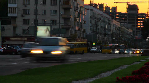 City traffic time lapse at dusk, cars lights pass by, gets dark Footage